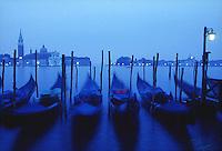 Moored gondole with the island of San Giorgio and San Giorgio Maggiore church in the background<br />