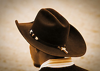 A bull rider waiting to for his ride.