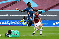 21st March 2021; London Stadium, London, England; English Premier League Football, West Ham United versus Arsenal; Lukasz Fabianski of West Ham United collects the ball from Bukayo Saka of Arsenal