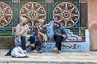 Chefchaouen, Morocco.  Men Talking in the Public Square.