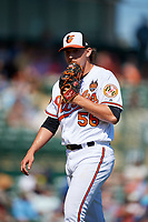 Baltimore Orioles relief pitcher Hunter Harvey (56) walks back to the dugout during a Grapefruit League Spring Training game against the Tampa Bay Rays on March 1, 2019 at Ed Smith Stadium in Sarasota, Florida.  Rays defeated the Orioles 10-5.  (Mike Janes/Four Seam Images)