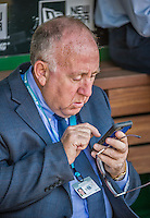 6 April 2015: New York Mets Vice President of Media Relations Jay Horwitz checks his messages in the dugout prior to the Season Opening Game against the Washington Nationals at Nationals Park in Washington, DC. The Mets rallied to defeat the Nationals 3-1 in their first meeting of the 2015 MLB season. Mandatory Credit: Ed Wolfstein Photo *** RAW (NEF) Image File Available ***