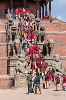 Bhaktapur, Nepal.  Nepalese Students in Uniform Visiting the Nyatapola Temple.  Guardians Line the Steps:  Jayamel (left), Phattu (right), Elephants, Lions, Griffins, and Goddesses Baghini and Singhini.  The temple survived the April 2015 earthquake virtually undamaged.