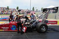 May 19, 2012; Topeka, KS, USA: NHRA crew members for top fuel dragster driver Scott Palmer during qualifying for the Summer Nationals at Heartland Park Topeka. Mandatory Credit: Mark J. Rebilas-