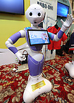 July 20, 2016, Tokyo, Japan - Softbank's humanoid robot Pepper wears wrapping sticker for his clotes designed by iJet at a press preview of the Pepper World exhibition in Tokyo on Wednesday, July 20, 2016. Pepper's latest applications and accessories will be exhibited at the Pepper World robot exhibition on July 21 and 22.      (Photo by Yoshio Tsunoda/AFLO)