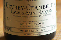 Closeup close-up of a wine bottle label Maison Domaine Louis Jadot Bourgogne Gevrey Chambertin Lavaux-Saint-Jacques Premier 1er Cru Appellation Controlee, Maison Louis Jadot, Beaune Côte Cote d Or Bourgogne Burgundy Burgundian France French Europe European