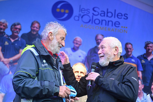 Jean-Luc Van Den Heede (left) being congratulated by Sir Robin Knox-Johnston after winning the 2018/19 Golden Globe Race. Photo credit: Christophe Favreau/PPL/GGR