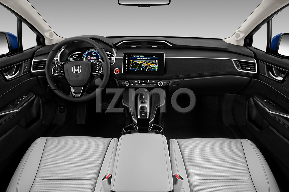 Stock photo of straight dashboard view of a 2017 Honda Clarity Electric 5 Door Hatchback