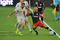 WASHINGTON, DC - SEPTEMBER 12: Federico Higuain #2 of D.C. United battles for the ball with Daniel Royer #77 of New York Red Bulls during a game between New York Red Bulls and D.C. United at Audi Field on September 12, 2020 in Washington, DC.