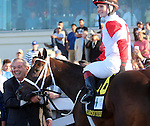 March 29, 2014: on Louisiana Derby Day at the Fairgrounds Race Course in New Orleans, LA. Mary M. Meek/ESW/CSM; Vicar's In Trouble wins the Louisiana Derby, ridden by Rosie Napravnik, owner Ken and Sarah Ramsey.