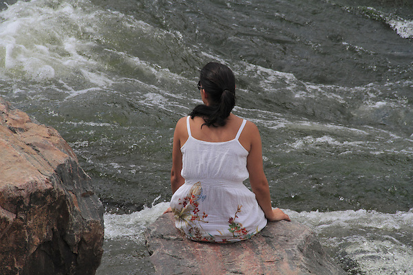 Woman sitting and resting along Boulder Creek, Boulder, Colorado. .  John offers private photo tours in Denver, Boulder and throughout Colorado. Year-round Colorado photo tours.