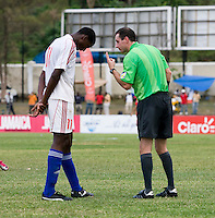 Daniel Luiz Saez (11) of Cuba is admonished by referee Paul Ward during the group stage of the CONCACAF Men's Under 17 Championship at Jarrett Park in Montego Bay, Jamaica. Panama tied Cuba, 0-0.