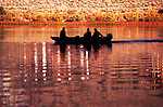 Three fisherman at dawn on June Lake, eastern Sierra Mountains, CA in October color.