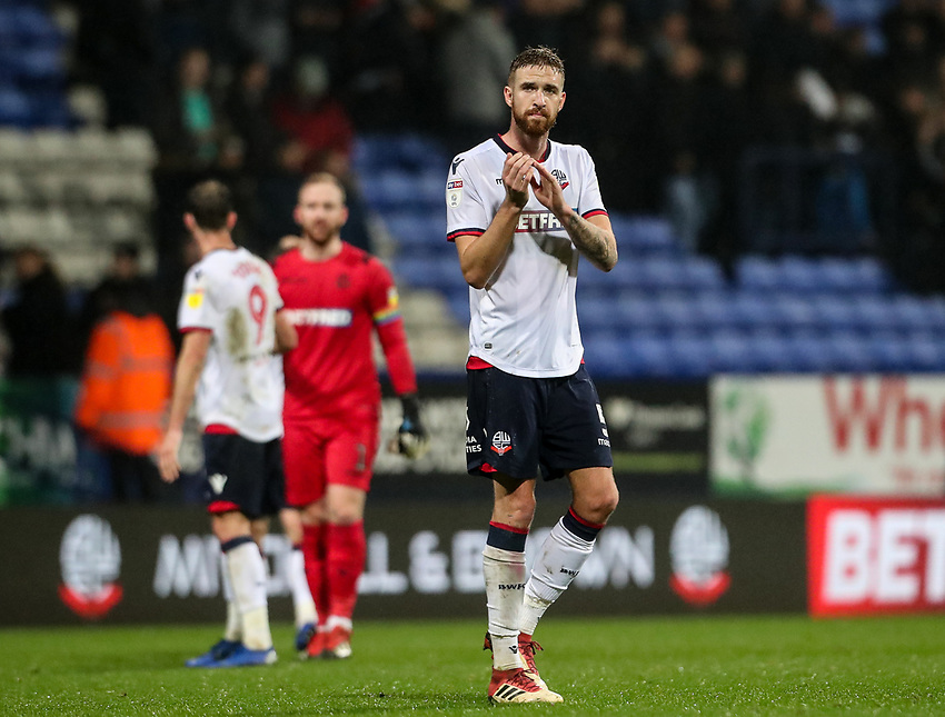 Bolton Wanderers' Mark Beevers applauds the home fans<br /> <br /> Photographer Andrew Kearns/CameraSport<br /> <br /> The EFL Sky Bet Championship - Bolton Wanderers v Wigan Athletic - Saturday 1st December 2018 - University of Bolton Stadium - Bolton<br /> <br /> World Copyright © 2018 CameraSport. All rights reserved. 43 Linden Ave. Countesthorpe. Leicester. England. LE8 5PG - Tel: +44 (0) 116 277 4147 - admin@camerasport.com - www.camerasport.com