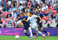 August 07, 2012..Mexico's Javier Aquino, Japan's Hiroshi Kiyotake and Japan's Yuhei Tokunaga in action during Semi Final match at the Wembley Stadium on day eleven in Wembley, England. Mexico defeat Japan 3-1 to reach Men's Finals of the 2012 London Olympics...