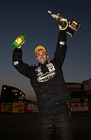 Feb. 17, 2013; Pomona, CA, USA; NHRA pro stock driver Vincent Nobile celebrates after winning the Winternationals at Auto Club Raceway at Pomona. Mandatory Credit: Mark J. Rebilas-