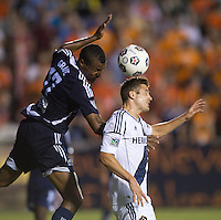 Robbie Rogers (14) of the LA Galaxy fights for the ball with Jordan Graye (17) of the Carolina Railhawks during a third round match in the US Open Cup at WakeMed Soccer Park in Cary, NC.  The Carolina Railhawks defeated the LA Galaxy, 2-0.