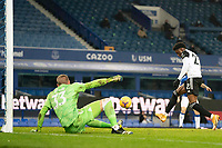 14th February 2021, Doddison Park, Liverpool, England;  Fulhams Josh Maja  scores his second goal past Evertons goalkeeper Robin Olsen during the Premier League match between Everton and Fulham at Goodison Park in Liverpool