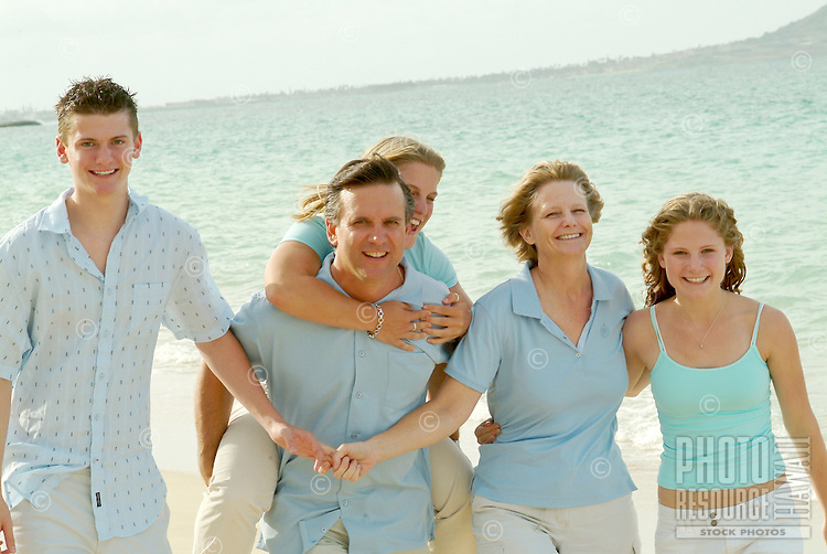 Family of five walking on the beach