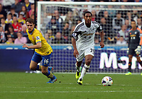 Saturday 28 September 2013<br /> Pictured: Jonathan de Guzman of Swansea (R) against Aaron Ramseyi of Arsenal (L)<br /> Re: Barclay's Premier League, Swansea City FC v Arsenal at the Liberty Stadium, south Wales.