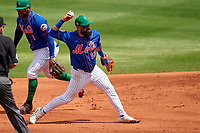 New York Mets shortstop Luis Guillorme (13) throws to first base during a Major League Spring Training game against the Washington Nationals on March 18, 2021 at Clover Park in St. Lucie, Florida.  (Mike Janes/Four Seam Images)