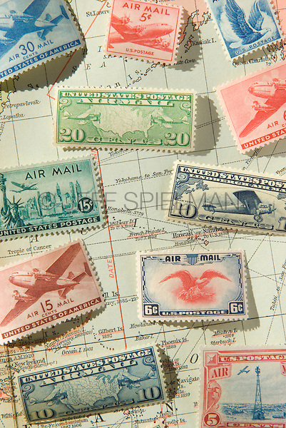 Old United States of America Airmail Postage Stamps and 1930 World Map<br /> <br /> AVAILABLE FOR COMMERCIAL OR EDITORIAL LICENSING FROM PLAINPICTURE.COM.  Please go to www.plainpicture.com and search for image # p569m791801.