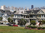 Row of Victorian Homes unique for its colorful (colourful)pastel exteriors, and typically seen in San Francisco, California, USA. (4)<br />