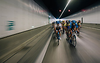 """peloton crossing the tunnel under the Antwerp harbour/port<br /> <br /> Antwerp Port Epic 2018 (formerly """"Schaal Sels"""")<br /> One Day Race:  Antwerp > Antwerp (207 km; of which 32km are cobbles & 30km is gravel/off-road!)"""