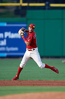 Philadelphia Phillies shortstop J.P. Crawford (12) throws to first base during a game against the Florida Fire Frogs while on rehab assignment with the Clearwater Threshers on June 1, 2018 at Spectrum Field in Clearwater, Florida.  Florida defeated Clearwater 12-10.  (Mike Janes/Four Seam Images)