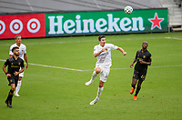 LOS ANGELES, CA - OCTOBER 25: Sacha Kljestan #16 of the Los Angeles Galaxy heads a ball during a game between Los Angeles Galaxy and Los Angeles FC at Banc of California Stadium on October 25, 2020 in Los Angeles, California.