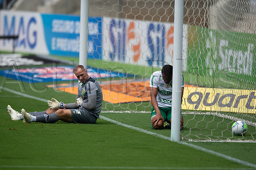 18th November 2020; Arena de Gremio, Porto Alegre, Brazil; Brazil Cup, Gremio versus Cuiaba; Joao Carlos and Ednei of Cuiabá sit dejected as the goal by Diego Souza of Gremio sits in the net in the 10th minute 1-0