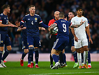 9th October 2021; Hampden Park, Glasgow, Scotland; FIFA World Cup football qualification, Scotland versus Israel;  Lyndon Dykes of Scotland remonstrates with the referee after his goal making it 2-2 is ruled out at first and goes to VAR and confirmed a goal