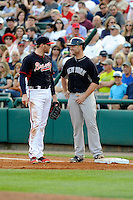 Catcher Brian McCann (34) of the New York Yankees, right, talks with Atlanta Braves first Baseman Freddie Freeman (5) during a Spring Training game against the Atlanta Braves on Wednesday, March 18, 2015, at Champion Stadium at the ESPN Wide World of Sports Complex in Lake Buena Vista, Florida. The Yankees won, 12-5. (Tom Priddy/Four Seam Images)