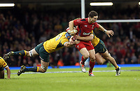 Pictured: George North of Wales (C) is brought down by James Hornwill (L) and another Australia player. Saturday 08 November 2014<br /> Re: Dove Men Series rugby, Wales v Australia at the Millennium Stadium, Cardiff, south Wales, UK.
