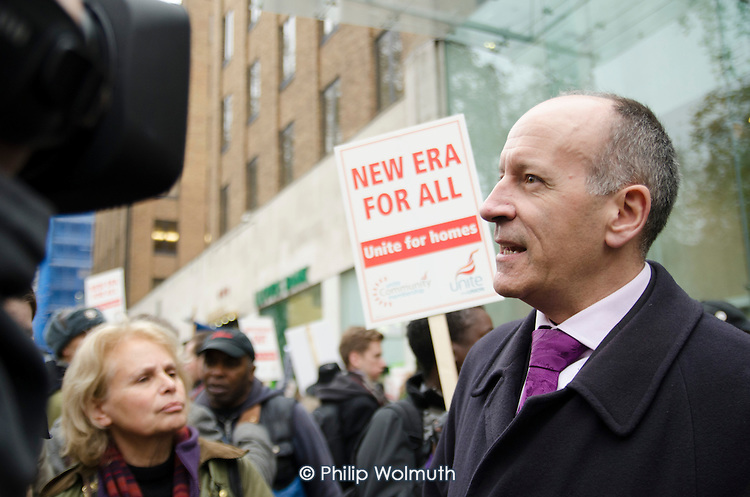 Mayor of Hackney Jules Pipe gives a TV interview as residents of the New Era Estate in Hoxton protest at proposed rent rises outside the Mayfair office of US property company Westbrook Partners.