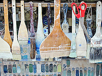 Potters glazing brushes and color samples.