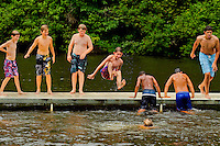 Swimming in the lake at Camp Raven Knob Scout Reservation, one of the largest Boy Scout camps in the United States. Camp Raven Knob is located within Boy Scouts of America's Old Hickory Council in Mt. Airy, North Carolina. Troops from across the US attend the camp's one-week residential boys' summer programs, which offer instruction on more than 40 merit badges, adventure programs and new Scout orientation.