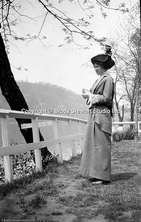 Highland Park: Sarah Stewart taking a break from a stroll through Highland Park with Brady Stewart.  Allegheny River in the background.  During this time, Brady Stewart lived at 5801 Wellesley Avenue in Highland Park not far from the park entrance.
