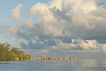 Moorea, French Polynesia; sunrise from abandoned, broken down pier with Sheraton Hotel bungaloes in the distance , Copyright © Matthew Meier, matthewmeierphoto.com All Rights Reserved