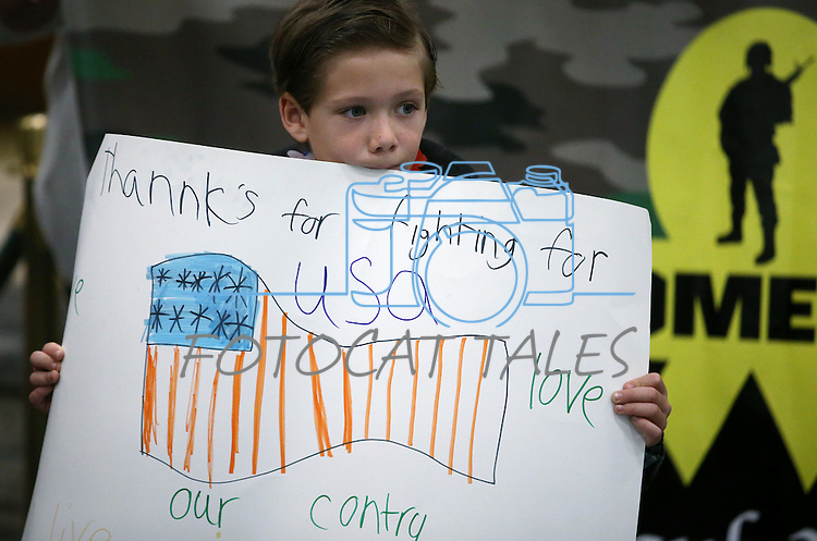 Austin Smith, 7, was among the 300 supporters at the Reno-Tahoe International Airport in Reno, Nev., on Sunday, Feb. 16, 2014 to welcome home Nevada Army Guard soldiers returning from a 10-month deployment to Afghanistan. (Las Vegas Review-Journal/Cathleen Allison)