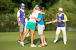 Lee Sharpe (in blue) congratulates Anna Nordqvist during the World Celebrity Pro-Am 2016 Mission Hills China Golf Tournament on 23 October 2016, in Haikou, Hainan province, China. Photo by Marcio Machado / Power Sport Images