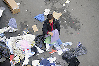 - Milano, al termine del mercato rionale anziani ed indigenti cercano fra gli stracci ed i rifiuti qualcosa di utile<br /> <br /> - Milan, at the end of the neighborhood market indigents and older people seek among the rags and wastes something useful