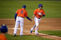 Syracuse Mets manager Tony DeFrancesco (11) congratulates Danny Espinosa (18) after hitting a home run during an International League game against the Charlotte Knights on June 11, 2019 at NBT Bank Stadium in Syracuse, New York.  Syracuse defeated Charlotte 15-8.  (Mike Janes/Four Seam Images)