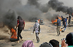 Palestinian protesters clash with Israeli security forces at tents protest where Palestinians demand the right to return to their homeland, in east of Gaza city on April 20, 2018. Photo by Atia Darwish
