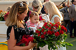 """DEL MAR, CA  AUGUST 17:  Manon Prat and baby Elana admire the flowers after #6 Higher Power, ridden by Flavien Prat, wins the TVG Pacific Classic (Grade 1) """"Win and You're In Breeders' Cup Classic Division"""" on August 17, 2019 at Del Mar Thoroughbred Club in Del Mar, CA. (Photo by Casey Phillips/Eclipse Sportswire/ CSM"""