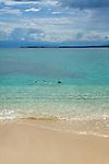 Girl snorkeling at the beach at Cayos Zapatillas, part of Bastimentos's National Marine Park, Bocas del Toro, Panama