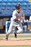 Charleston RiverDogs center fielder Jeff Hendrix (6) runs to first during game one of a double header against the Asheville Tourists at McCormick Field on July 8, 2016 in Asheville, North Carolina. The RiverDogs defeated the Tourists 10-4 in game one. (Tony Farlow/Four Seam Images)