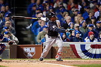 Cleveland Indians Jose Ramirez (11) hits a home run in the second inning during Game 5 of the Major League Baseball World Series against the Chicago Cubs on October 30, 2016 at Wrigley Field in Chicago, Illinois.  (Mike Janes/Four Seam Images)