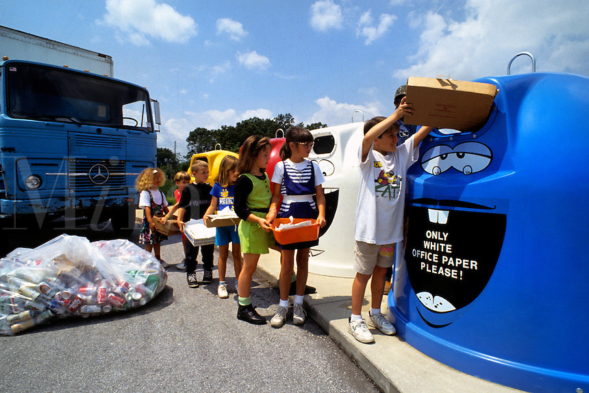 Environment Children bringing cans and cardboard to be recycled at school organized recycle bi
