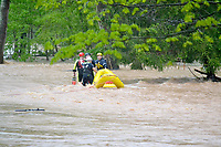 Bella Vista and Rogers Fire Department water rescue personnel assisted Little FLock in rescuing two men from the flood waters on Rustic Drive in Little Flock as well as five people and two dogs from a residence at 1626 Rustic Dr.
